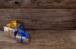 Gift boxes on wooden board background royalty free stock image