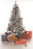 Gift boxes wrapped under the Christmas tree Royalty Free Stock Photography