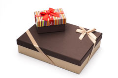 Gift boxes are wrapped up by tapes a white background. Stock Photos