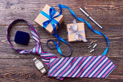 Gift boxes and wrist clock. Stock Image