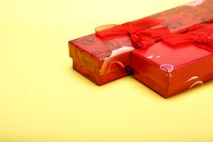 Gift boxes on yellow background for St. Valentines day.  Stock Photos
