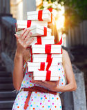 Gift boxs in the hands of young woman Stock Image