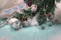 A gift, a branch of spruce, Santa Claus, the text Happy New Year Royalty Free Stock Image