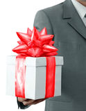 Gift and the businessman. The businessman offering to you a gift Royalty Free Stock Photo