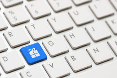 Gift button on keyboard with soft focus Stock Photography