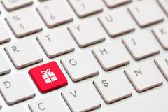 Gift button on keyboard with soft focus Stock Photos