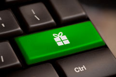 Gift button on keyboard with soft focus stock image