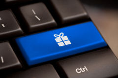 Gift button on keyboard with soft focus stock photo