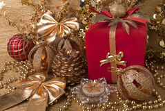 Gift, candles, new year balls Royalty Free Stock Photo