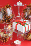 Gift, candles and pine cones Royalty Free Stock Photography