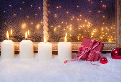 Gift and candles, window Royalty Free Stock Photo