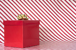 Gift on candy cane stripes Royalty Free Stock Photography