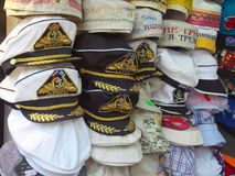 Gift captain's hats are sold in souvenir Sochi ranks. Sochi, Russia - June 25, 2014: Gift captain's hats are sold in souvenir Sochi ranks Stock Images