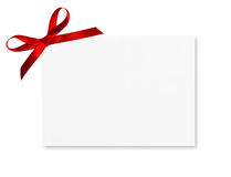 Gift Card. Tied with a bow of red satin ribbon. Isolated on white background Royalty Free Stock Images