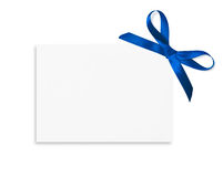 Gift Card. Tied with a bow of blue satin ribbon. Isolated on white background Stock Images