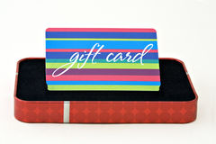 Gift Card. Displayed in a gift box isolated on a white background Royalty Free Stock Photography