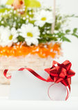 Gift card against basket of flowers Stock Photo
