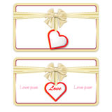Gift card with a bow and a heart with love Royalty Free Stock Photo