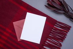 Gift card and burgundy wrap on a gray background royalty free stock photo