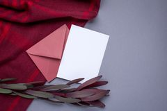 Gift card and burgundy wrap on a gray background royalty free stock image