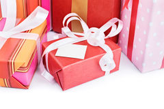 Gift with a card. Close-up shot of gift boxes with a greeting card isolated on white background Royalty Free Stock Images