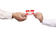 Gift card concept. Close up of hands holding gift card Royalty Free Stock Photos