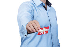 Gift card concept. Man offering small gift card Royalty Free Stock Photo