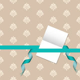 Gift card with damask pattern and green ribbon Stock Images