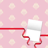 Gift card with damask pattern and red ribbon Stock Images