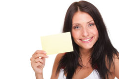 Gift card. Excited woman showing empty blank paper card sign. Female model studio shot isolated Stock Photos