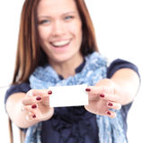 Gift card. Excited woman showing empty blank paper card sign Stock Photography