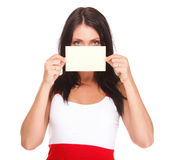 Gift card. Excited woman showing empty blank paper card sign. Female model isolated Royalty Free Stock Images