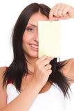 Gift card. Excited woman showing empty blank paper card sign Royalty Free Stock Photography