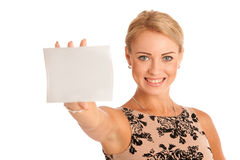 Gift card. Excited woman showing empty blank paper card sign wit. H copy space for text. Caucasian female model isolated over white background Royalty Free Stock Photo