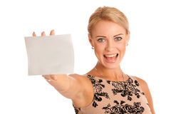 Gift card. Excited woman showing empty blank paper card sign wit Royalty Free Stock Photography