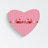 Gift card in the form of heart for Valentine's day. Knitted pink heart with  ribbon Royalty Free Stock Photo