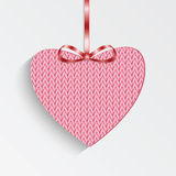 Gift card in the form of heart for Valentine's day. Knitted pink heart with  ribbon Royalty Free Stock Photos