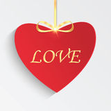 Gift card in the form of heart for Valentine's day. Red heart with golden ribbon Royalty Free Stock Image