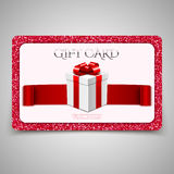 Gift card with gift box and red glitter Stock Photos