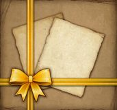 Gift card with gold bow Stock Photography