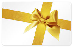 Gift card with golden ribbon bow Isolated on white Royalty Free Stock Photo