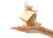 Gift with card in hand Stock Photos