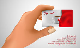 Gift card in hand Royalty Free Stock Image