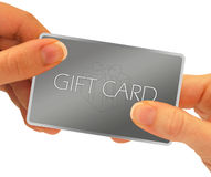 Gift card hands. A gift card being exchanged through hands - isolated over a white background.  A clipping path is included Royalty Free Stock Image