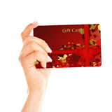 Gift card holded by hand over white. Background Royalty Free Stock Image