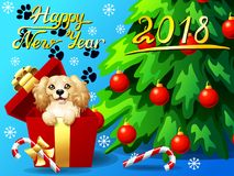 Card Cocker Spaniel in a gift box and fir. Gift card with an inscription of Happy New year 2018, a dog in a box, a fir-tree with jewelry and a Candy cane. A Royalty Free Stock Photo