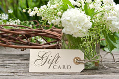 Gift card. Lily of the valley, snowball and label with lettering gift card Stock Image