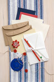 Gift card making supplies. Stationary, envelopes, cards, paper, pins, string, buttons and fabric on wood table Stock Photo