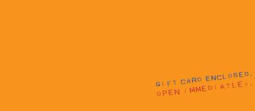 Gift card message. Text Gift Card Enclosed Open Immediately in uneven print on an orange rectangular background Stock Photos