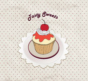 Gift card with pastry. Muffin on napkin in retro style over polka dot seamless pattern. Sweets  set. Royalty Free Stock Photos